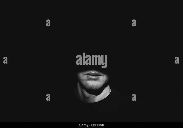 Sunlight Falling On Man In Darkroom - Stock Image