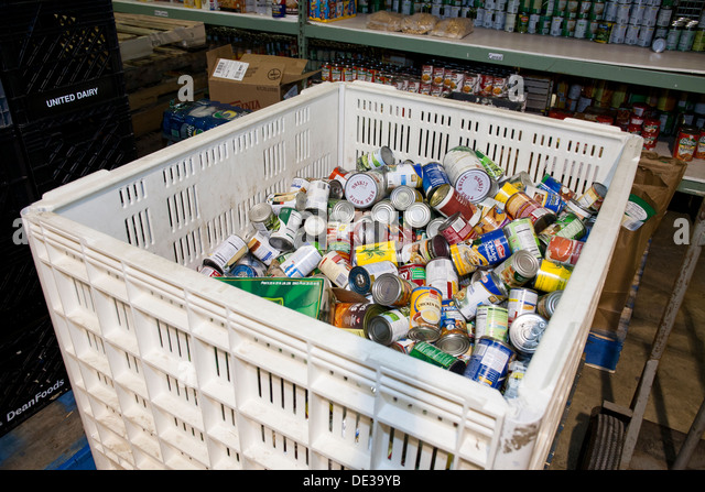 Donated canned food at food bank - USA - Stock Image