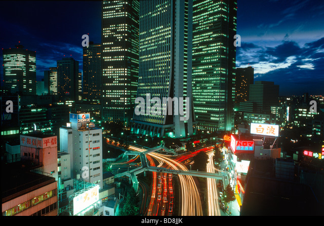 Tokyo traffic and skyscrapers at night in Shinjuku District - Stock Image