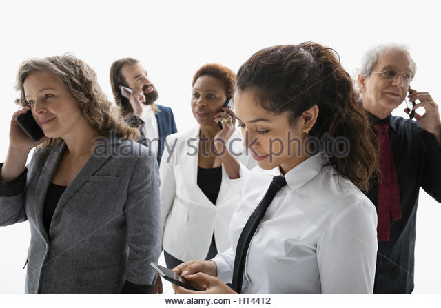 Business people texting and talking on cell phones against white background - Stock-Bilder