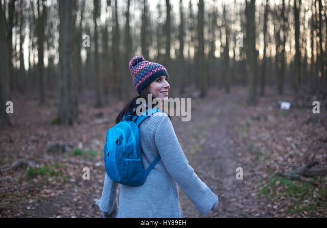 A woman on a country walk in the woods - Stock Image