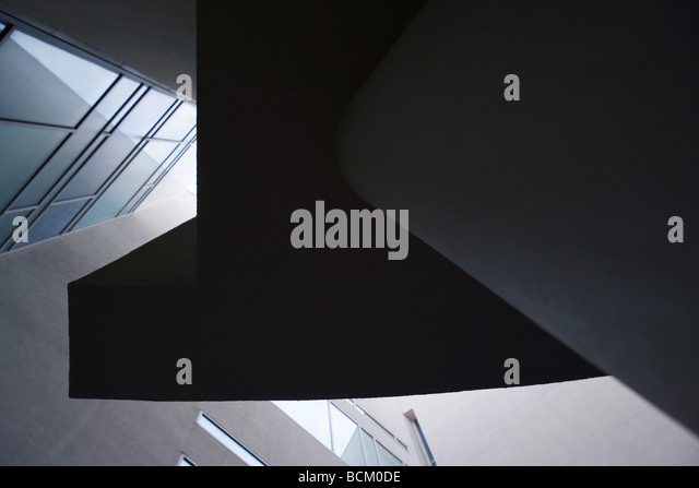Architectural shot, concrete and glass, low angle view - Stock Image