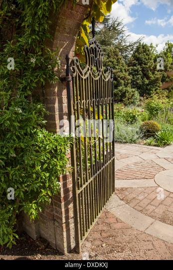 Wrought Iron Garden Gate Looking Onto Garden   Stock Image