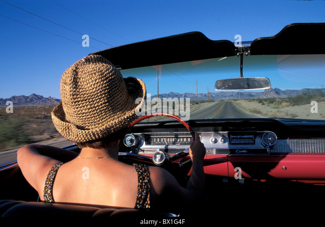 vintage car automobile car convertible country road hat Highway model released moving old timer street US - Stock Image