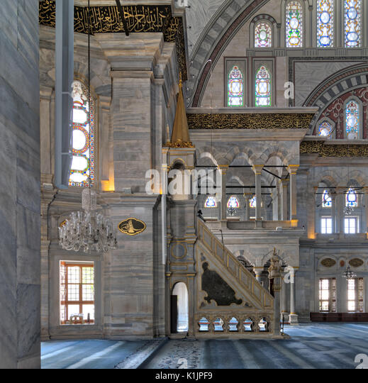 Interior shot of Nuruosmaniye Mosque, an Ottoman Baroque style mosque with minbar (platform), arches & colored - Stock Image