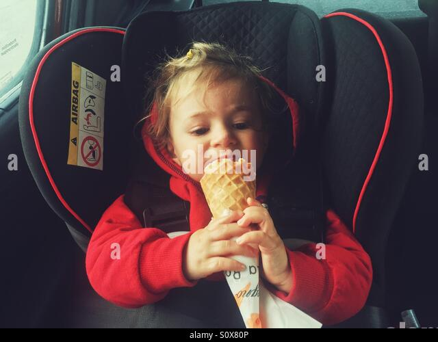 one year old baby eating ice cream - Stock Image