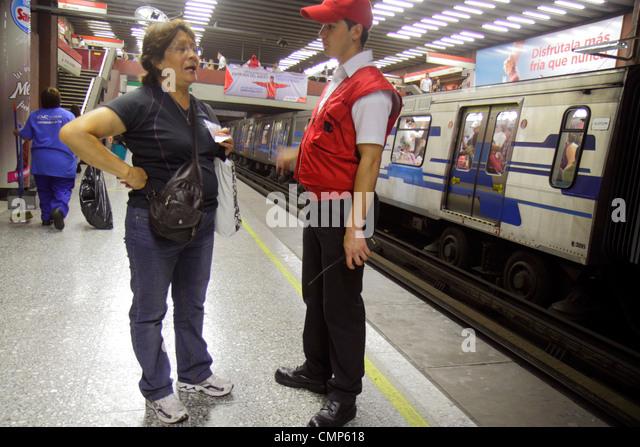 Chile Santiago Metro Station Universidad de Chile subway public transportation rapid transit train Hispanic man - Stock Image