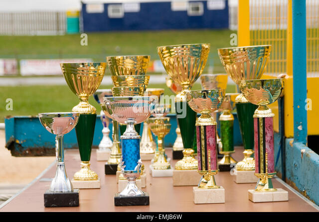 trophy trophies cheap plastic plasticky  cup cups rubbish - Stock Image