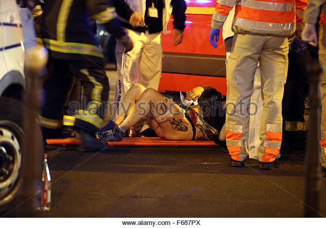 Paris, France. 14th Nov, 2015. Victims of the shooting at the Bataclan concert venue in central Paris are being - Stock Image