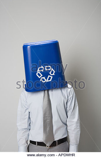 Businessman with recycling bin over head - Stock Image