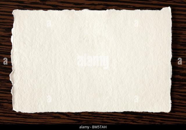 white paper on wooden background - Stock-Bilder