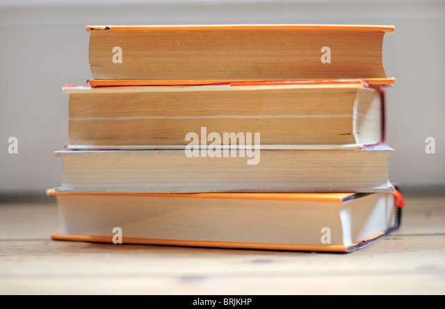 Stacked books, close-up - Stock Image