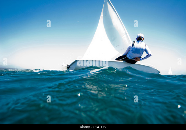 A female athlete races a boat during a training session in Mexico. - Stock Image