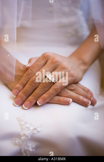 Close up of bride s hands and engagement ring - Stock-Bilder