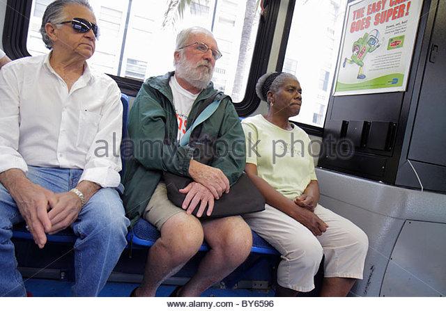 Miami Beach Florida Miami-Dade Metrobus South Beach Local passengers Black woman Hispanic man senior - Stock Image