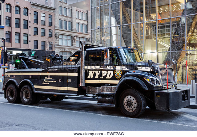 New York City NY NYC Manhattan Lower Financial District NYPD vehicle heavy tow truck - Stock Image