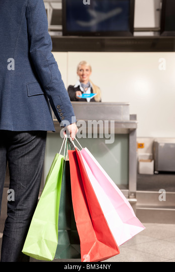 Woman with shopping bags traveling - Stock-Bilder