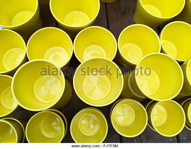 Full Frame Shot Of Empty Yellow Drinking Glasses On Table - Stock Image