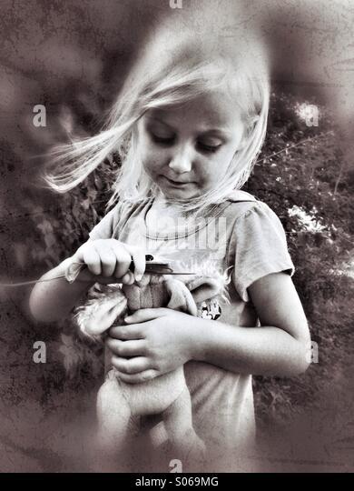 Mommy feeding puppy. - Stock Image