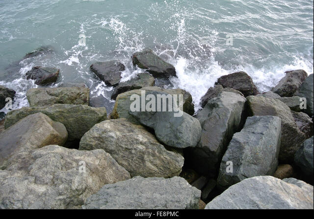 Sea Waves Smashing Against Boulders - Stock Image
