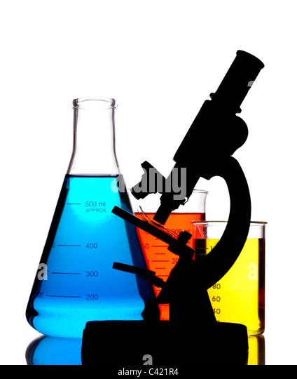microscope and laboratory glassware - Stock Image