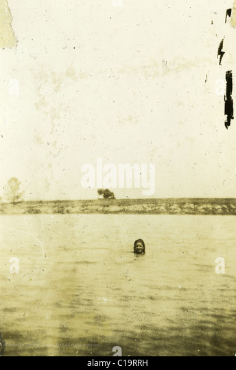 girl swimming in lake summer mid 1940s WWII era Indiana - Stock Image