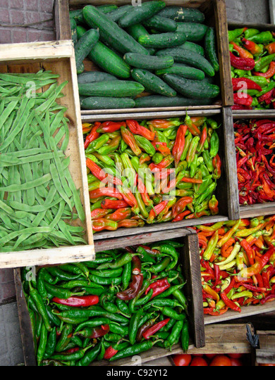 Montevideo, Montevideo, Uruguay Display of green cucumbers, chilies and beans. - Stock Image