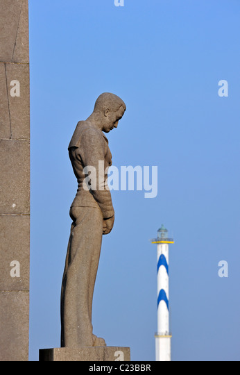 Monument for the sailors and fishermen who died at sea and the lighthouse Lange Nelle at Ostend, Belgium - Stock Image