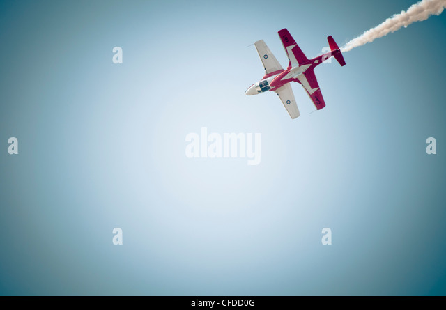 Two planes fly top to top during the snowbirds aerial performance in Comox, Vancouver Island, British Columbia, - Stock Image