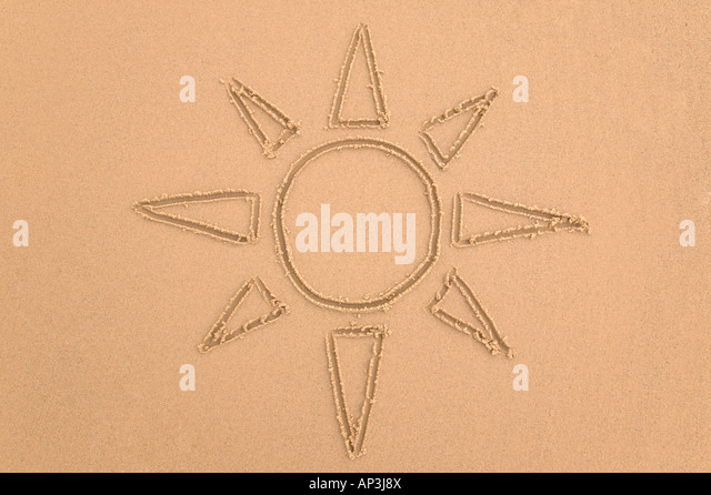 Drawing of the sun done in sand - Stock Image