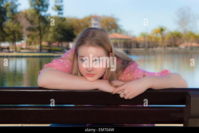15-16 year years old Caucasian teen girl reading the Bible meditating reflecting on God's Word. MR - Stock-Bilder