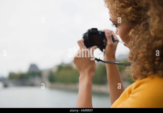 African woman taking photograph - Stock-Bilder