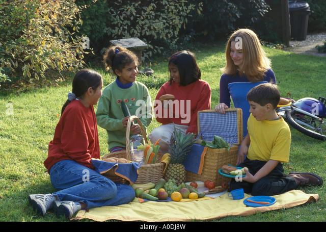 children having a picnic - Stock Image