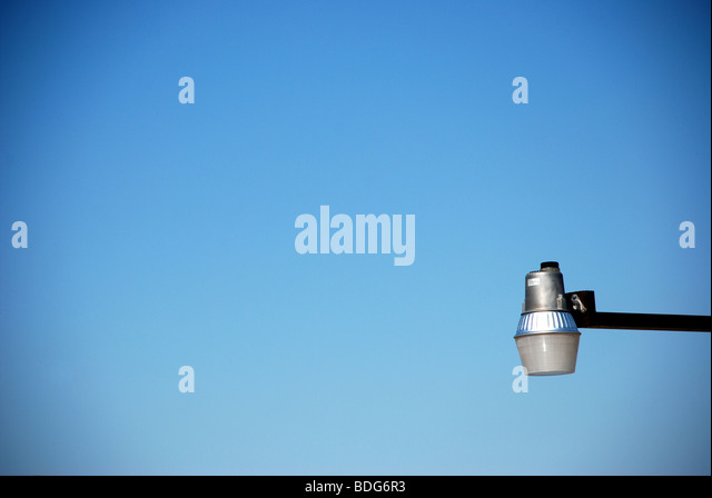 Street Lamp against clear blue sky - Stock Image