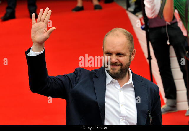 Karlovy Vary, Czech Republic. 9th July, 2015. Czech producer David Ondricek greets fans as he arrived to unveiling - Stock-Bilder