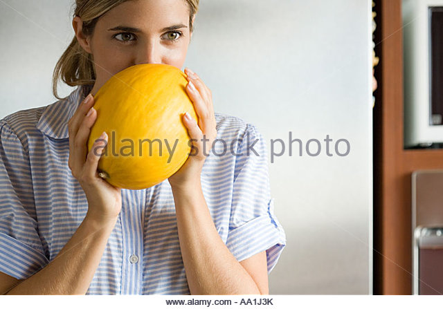 Woman holding a melon - Stock Image
