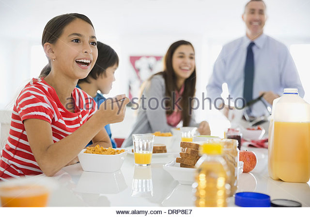 Girl eating breakfast cereal - Stock Image
