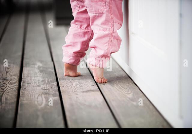 Little girl reaching up - Stock Image