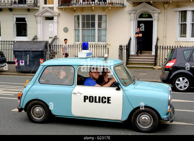 Brighton, UK. 22nd May 2016. Fake mini police car at the conclusion of the London to Brighton Mini Run which assembled - Stock Image
