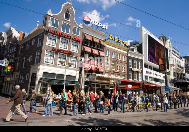 Amsterdam Rembrandtsplein street cafes peole - Stock Image