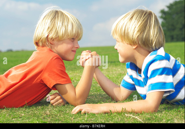 two boys arm wrestling - Stock Image