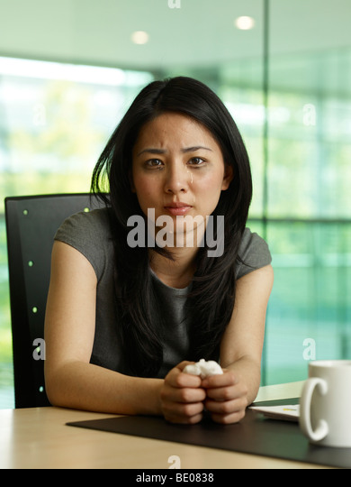 Portrait of a business woman crying - Stock Image