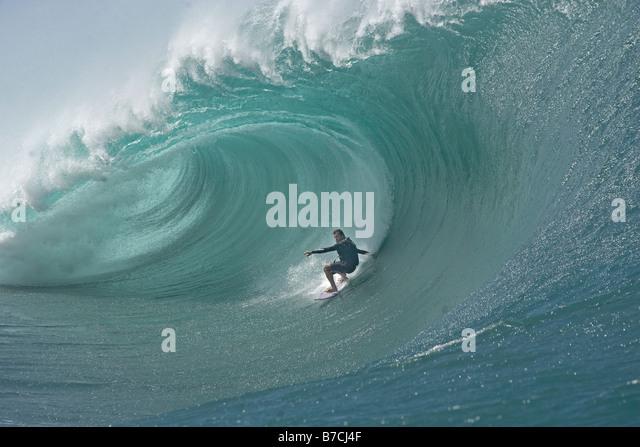 Carlos Burle surfing at Teahupoo Tahiti - Stock Image
