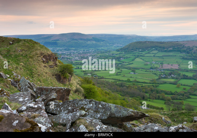 Rolling countryside looking towards Abergavenny from the summit of The Skirrid (Ysgyryd Fawr) mountain, Brecon Beacons - Stock Image