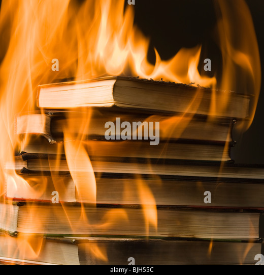 stack of books on fire - Stock Image