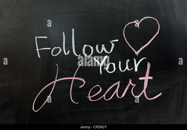 Conceptional chalk drawing - Follow your heart - Stock Image