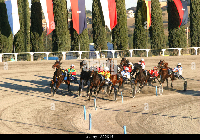 Racing of the popular Italian equestrian sport of Trotting at the Ippodromo at San Georgio in Le Marche ,Italy - Stock Image