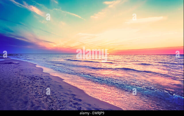 Magical sunset over Baltic Sea coast, Miedzyzdroje in Poland. - Stock Image
