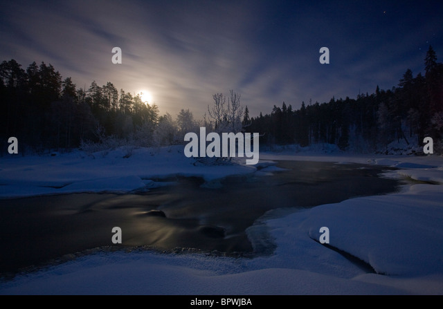 Moonrise on the Oulanka River in Oulanka National Park, Finland. - Stock Image