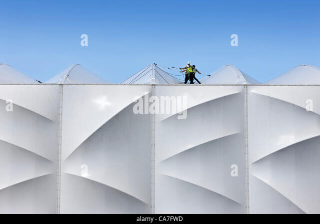 Workers giving a final clean to the roof of the Basketball Arena prior to the London 2012 Olympic Games - Stock Image